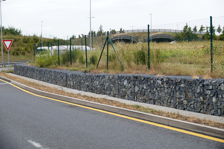 Protection of the escarpment against landslides. Gabions. Stock Photo