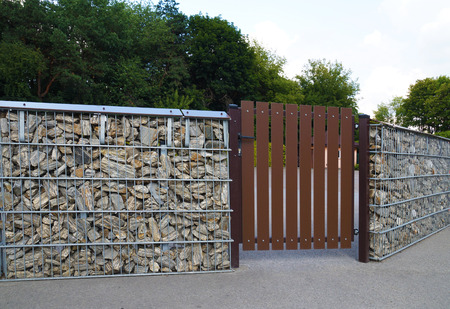 Gabion. Interesting way of making a low fence with the help of unusual stones.