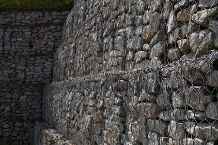 Gabions. Steel nets filled with granite debris protect the ground from slipping.