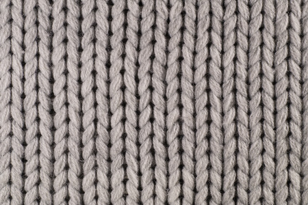 Knitwear. Close-up of a fragment of a knit with a thick weave of yarn.
