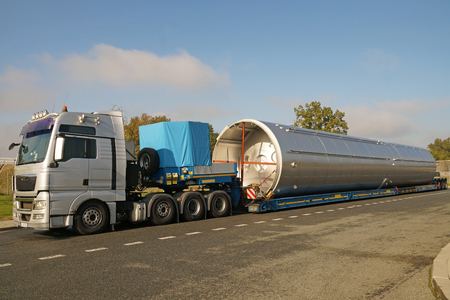 A truck with a special semi-trailer for transporting oversized loads. Oversize load, long load or convoi exceptionnel.