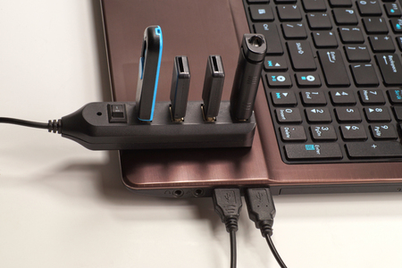 Fully used USB hub (each device has a device plugged into it) connected to the laptop.