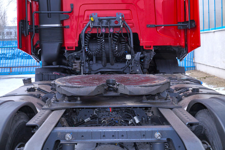 View of the back part of the 18 wheeled truck. Visible fifth wheel couplings are fitted to a tractor unit to connect it to the trailer.