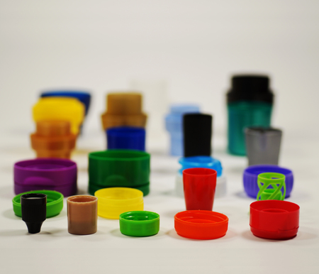 Recycling. Different shaped and colored caps from bottles, containers, creams and pastes.