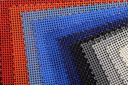 Advertisement. Color chart of one of the most popular advertising media: PVC coated banner type - mesh-macro. Stock Photo