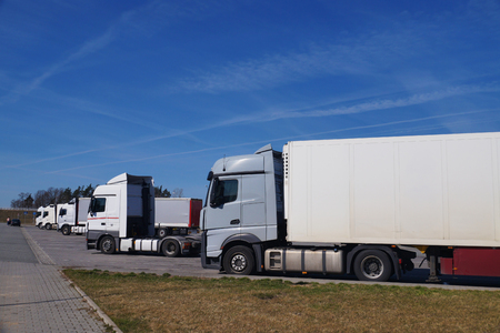 A row of trucks in the parking lot. Rest area for drivers. Stock Photo