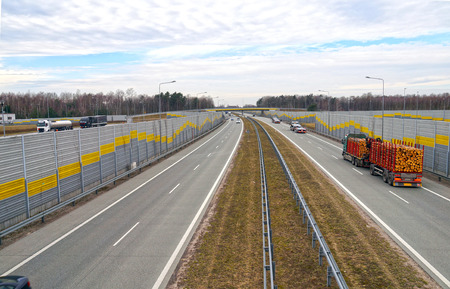 Highway. Sound-absorbing barriers reducing the noise generated by car traffic.