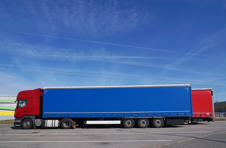Parking for trucks. Rest area for drivers near the highway. Stock Photo