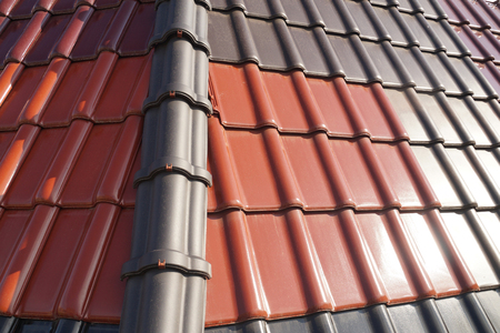 Roofing. Roof covered with tiles in different colors.