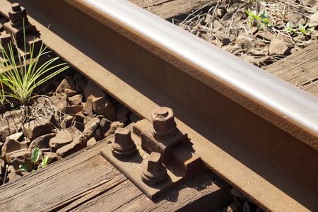 Rails fastened with screws to the railway sleeper. Wooden railway sleeper. Reklamní fotografie