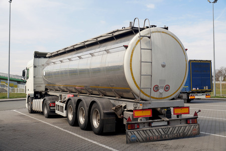 Long vehicle.. A truck with a tanker designed to transport food products. Reklamní fotografie