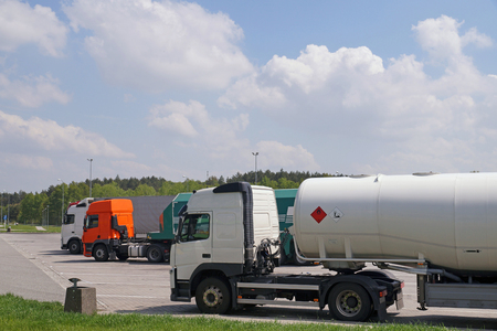 A variety of heavy goods vehicles while resting on the go. Parking for trucks. Reklamní fotografie
