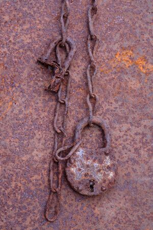 Sheet, padlock and chain. Corrosion of metal objects.