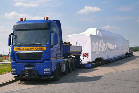 A truck with a special semi-trailer for transporting oversized loads. Oversize load, long load or convoy exceptional (convoi exceptionnel).