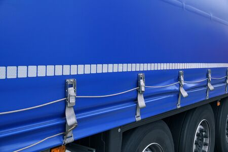 Truck transport. View of the tarpaulin covering the semi-trailer of the truck. Reklamní fotografie