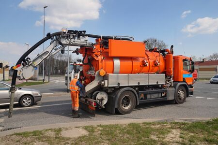 Worker and specialist car. Cleaning sewer manholes. Stock fotó