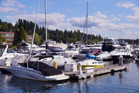The marina is filled with yachts and motorboats moored here. Lake washington.