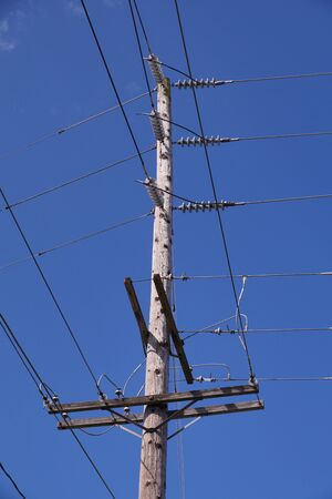 Classic wooden pole with electrical installations. USA.