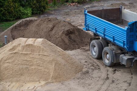 Soil and sand brought in by trucks. Construction site. Stockfoto