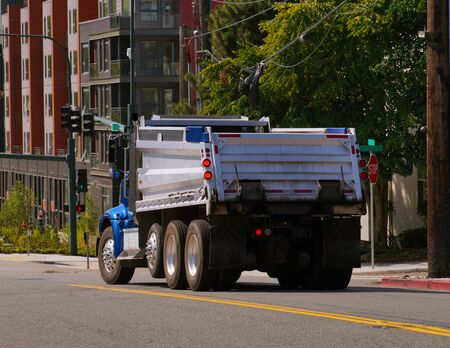 A city in the USA. Truck (dumper) in urban traffic.