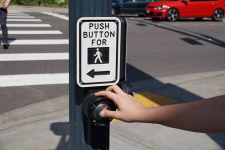 Pedestrian presses the button. A pedestrian light switch with voice guidance and comprehensive operating instructions.