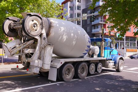 Mixer trucks in city traffic. A city in the USA.