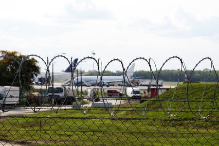 Securing the area. Airport area surrounded by barbed wire.  Stock fotó