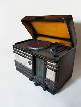 Old tube radio with a gramophone. Varnished casing, fabric, first plastics