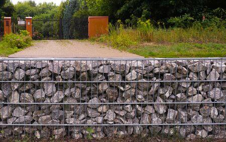 Arrangement of space. Wall of stones (gabions).