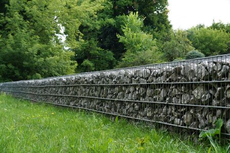 In the park. An effective, quick to install wall made of gabions.  Stock fotó