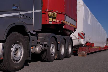 Travel break. Close-up of a specialist truck for transporting oversized loads.  Stock fotó