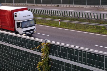 Autumn. Acoustic barriers on the highway covered with climbing plants.  Stock fotó