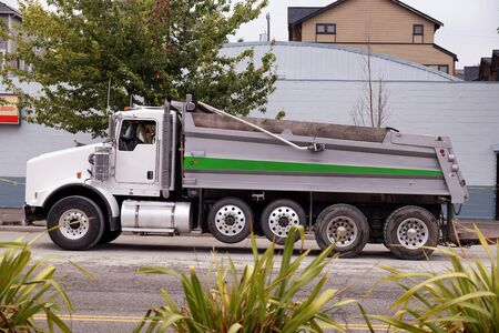 A large dump truck waiting to be loaded. Road works in the city center. Stock Photo