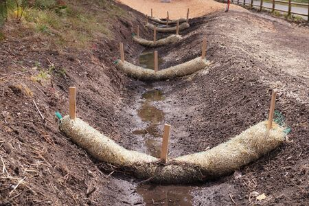 Land drainage works. The use of straw wattles.