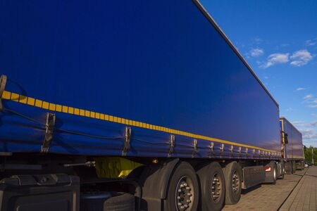 Truck transport. View of the tarpaulin covering the semi-trailer of the truck. Stock Photo