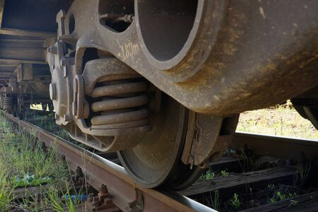 Wheels, brakes, rails. Fragment of a freight train chassis.