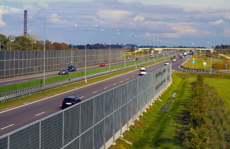 Departure from the resting place of travelers. A fragment of the highway protected by acoustic screens.