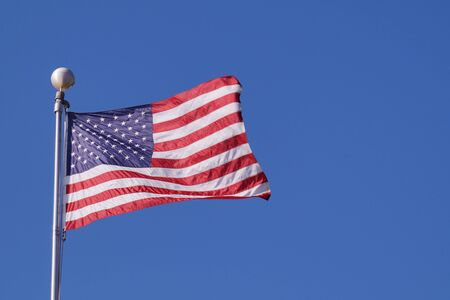 Symbol of the united state. The American flag flutters in the wind.
