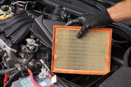 Replacing the car air filter. Car repair shop.