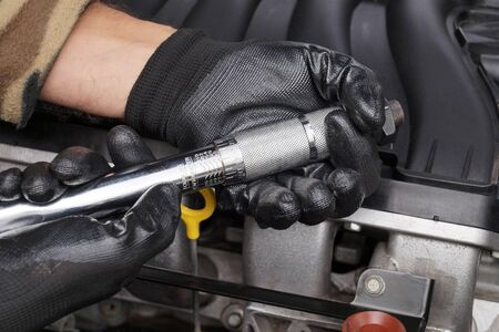 Setting the appropriate tightening force on the torque wrench. Car repair shop.  Stock Photo