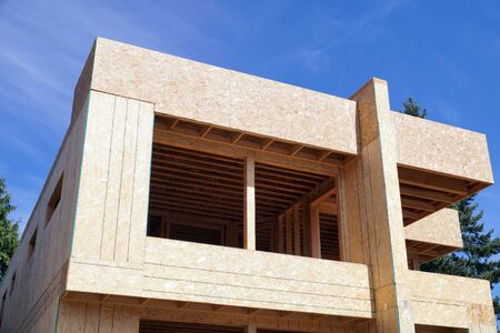 The house under construction.Oriented strand board (OSB). The most popular construction and building material in the USA.  Stock Photo