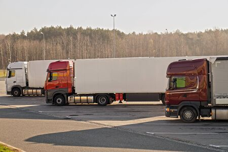 Autumn cold morning.Trucks parked in a roadside parking lot.  Stock Photo