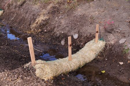 Land drainage works. The use of straw wattles (straw worms, bio-logs, straw noodles). 版權商用圖片