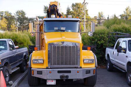 Car repair workshop. Boom truck (rush crane truck) on parking.  Stock Photo