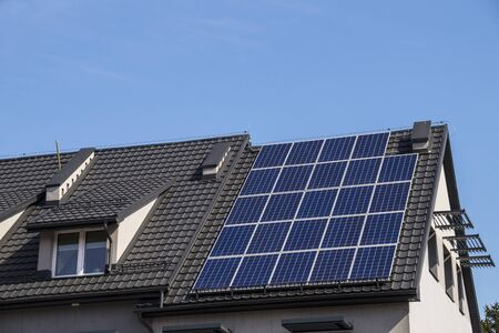 Installed solar panels. The roof of the building made of metal tiles. Standard-Bild