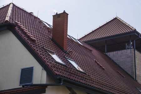 The roof is made of ceramic tiles. A newly built house.