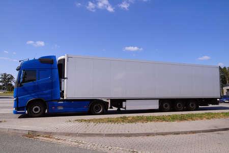 Break in a trip. A blue truck with a white trailer.