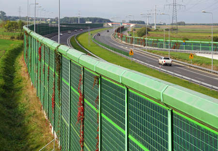 The motorway is protected on both sides with noise barriers. Barriers protect local residents from traffic noise.