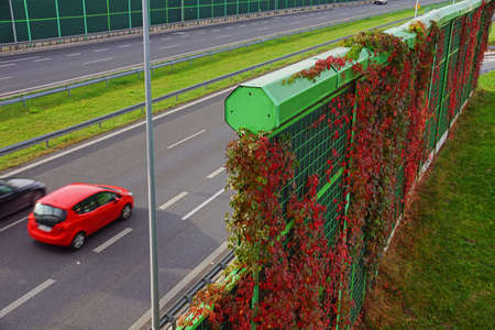 Noise barriers on the motorway. Barriers protect local residents from traffic noise.