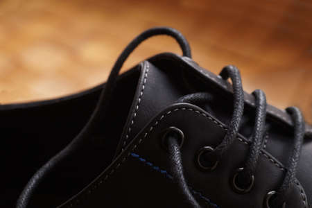 A close-up of the laces of a classic, elegant shoe. Men's shoes.